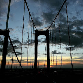 Sunset behind the bridge by Caleb Daniel - Buildings & Architecture Bridges & Suspended Structures ( clouds, skyline, sky, color, sunset, bridge,  )