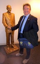 Photo: Greeting Paul Harris in Front of Room 711 groundfloor RI Headquarter