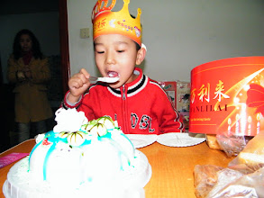 Photo: baby son, warrenzh, 朱楚甲 enjoy his cake after a day reunited with his dad, benzrad in his dorm, while his mom, emakingir beautified herself alone.