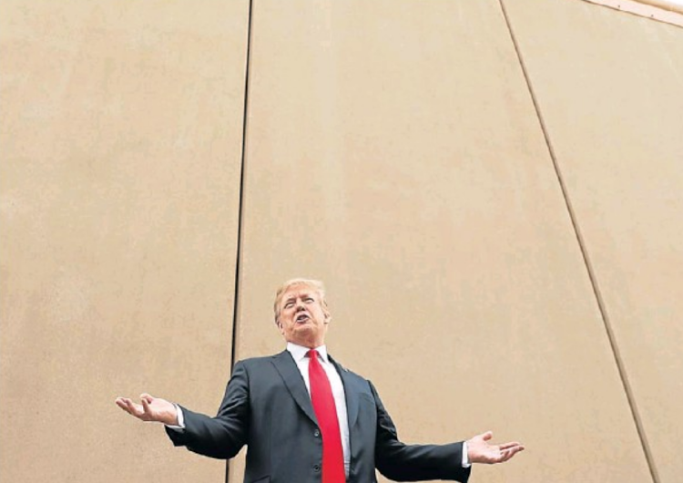 President Donald Trump at a US-Mexico border wall prototype while on a tour near the Otay Mesa Port of Entry in San Diego, California, on March 13, 2018