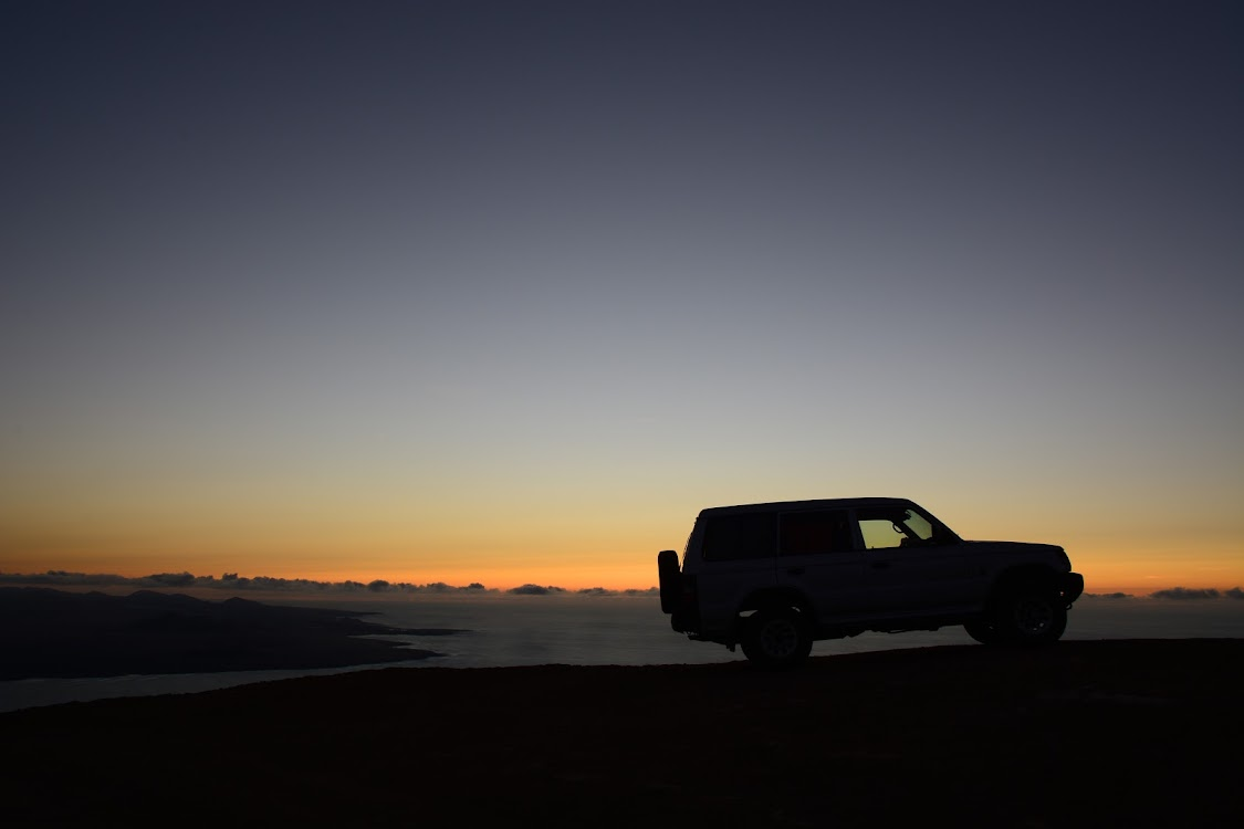 Silhouette of 4x4 vehicle on the coast
