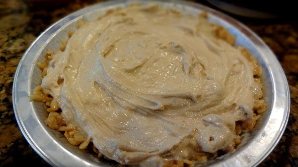 Spoon the ice cream into the chilled, prepared pie pans. Smooth the top and...