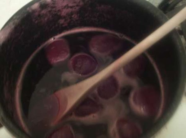 Add the drained beets to the boiling syrup. Return to a boil and take...