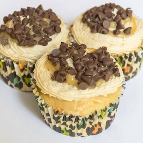 Chocolate topped salted caramel cupcakes! by Nicole Mitchell - Food & Drink Cooking & Baking ( chocolate chips, sweet, cupcake, frosting, caramel, salted )