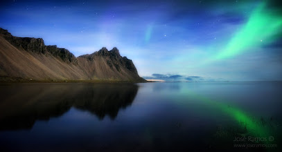 """Photo: """"The Gathering""""  After 30 hours of non-stop shooting and driving, an incredible gathering in front of me: the majestic mountains of Vestrahorn on the left, the last sparks of the Northern Lights on the right, and the glimpse of the coming twilight in the center.  The previous day had started by waking up near sunrise, after sleeping inside the car (and after a 200km ride during the night). We decided to sleep at Jokulsarlon, and at 5am we were headed right off to the ice beach, under extremely cold weather. As usual, got soaked up to my knees and only had my first meal at 15:00, after driving 80km to Hofn. The weather changed in an unexpected way, so I cancelled the plan of shooting Vestrahorn in the afternoon, and headed back to Jokulsarlon, which meant another 80km trip. According to the forecast there would be a 2 hour window with clear skies during the night in Jokulsarlon, which could mean finally being able to witness the Northern Lights again. When we arrived to the Jokulsarlon lagoon, light didn't look that good but I hoped it would get better as the sun would set behing the glaciar mountains. Fortunately it did, and we were treated with an incredibly display of light and colors. Once more, extremely cold temperatures and I was the only crazy guy soaked to my thighs in freezing water, thanks to the neoprene gear. When it got dark we headed to the car to grab some sandwiches and waited a bit to see if there would be any Auroras tonight. The Aurora forecast wasn't good, with just a """"2"""" rating in Vedur.is, even though we had clear skies, but the most beautiful natural phenomenon in the world finally made it's appearance! After spending two hours shooting it, and as it got more faint, I decided to still head back to Vestrahorn, for yet another 80km, only made possible through some cheap energy drinks filled with caffeine, available everywhere in Iceland. My companion was absolutely exhausted, so she decided to say in the car, but I was feeling like it cou"""