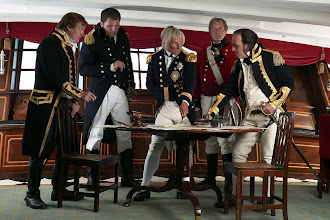 Photo: Nelson plans military strategy in his cabin with officers (Hardy is second from left)
