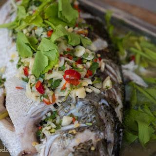 Steamed Fish with Lime and Garlic Recipe (ปลากะพงนึ่งมะนาว) Recipe