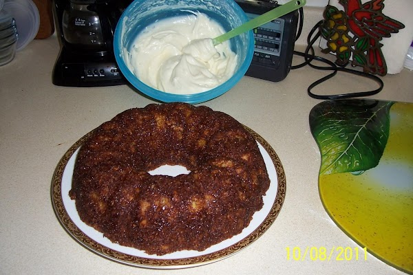 CAKE:  Grease and lightly flour bundt pan.In a large bowl mix together flour,...