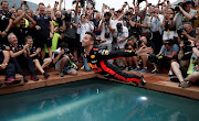 Red Bull feature prominently in the Netflix series, including their split with Renault and Australian driver Daniel Ricciardo (pictured), seen here celebrating after winning last year's Monaco Grand Prix.