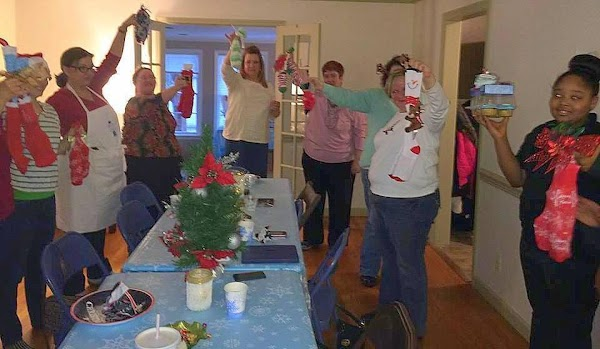 Here we are last year playing the http://www.justapinch.com/recipes/non-editible/other-non-edible/a-right-family-christmas.html. Just click on this link and...