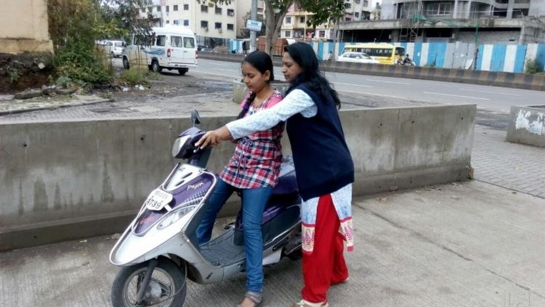 Image result for driving scooty