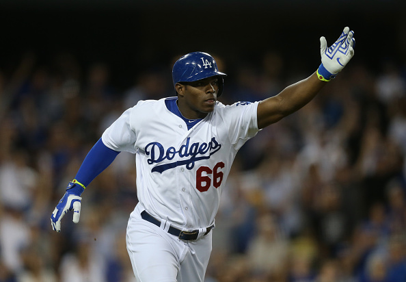 LOS ANGELES, CA - SEPTEMBER 24:  Yasiel Puig #66 of the Los Angeles Dodgers celebrates after hitting a solo home run against the San Francisco Giants in the sixth inning at Dodger Stadium on September 24, 2014 in Los Angeles, California.  (Photo by Jeff Gross/Getty Images)