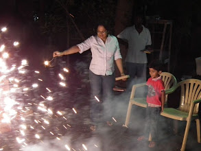 Photo: The fireworks begin - Sudha entertains Adhish, Karthik and Tamilarasi's son.