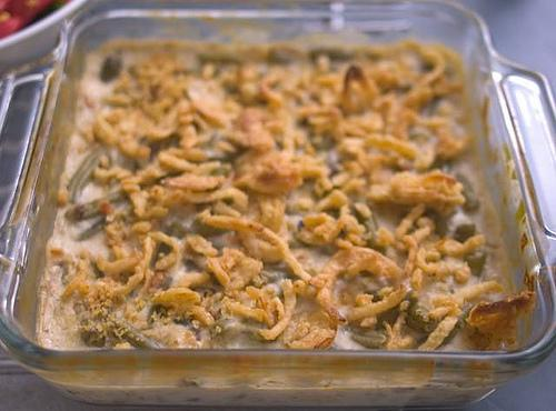 POUR INTO BAKING PAN.  BAKE 25 MINUTES.  SPRINKLE WITH FRENCH FRIED ONIONS...
