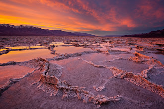 Photo: SaltWorks, Death Valley National Park, CA#landscapePhotography  #photographyworkflow  #photographytips Exposure: 1.6s | F16 | ISO 100Software: Photoshop | Adobe Camera RAWWorkflow:This image showcases the repeating patterns formed at Badwater in Death Valley.If you view this at LARGE SIZE you will notice the tiny details in salt formation stand out dramatically in the foreground due to the fact that the camera was place rather low on the ground. It was only about 1 - 1.5 feet above the ground level. Exposure between the sky and ground was controlled using a soft 0.6 ND filters. Even with a GND filter areas of the sky to the left were over exposed and needed manual blending using our (iHDR workflow) to bring out the details in the highlights. If you notice a bit more closely you can actually see the reflections of the cloud patterns on the water in the mid ground.Question: Why kind of lighting was used to bring out the textures in the fore and mid ground?Enjoy & Share.___________