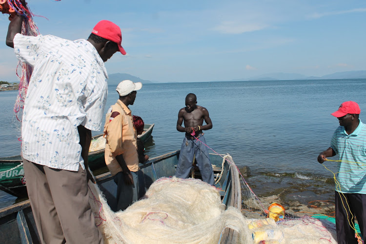 Fishermen prepare nets for fishing expectdition in Mbita, Homa Bay on March 25, 2021