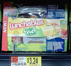 Photo: Going into the cold section I picked up a couple Lunchables for the girls.