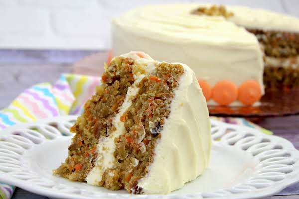 A Slice Of The Best Carrot Cake On A White Plate.
