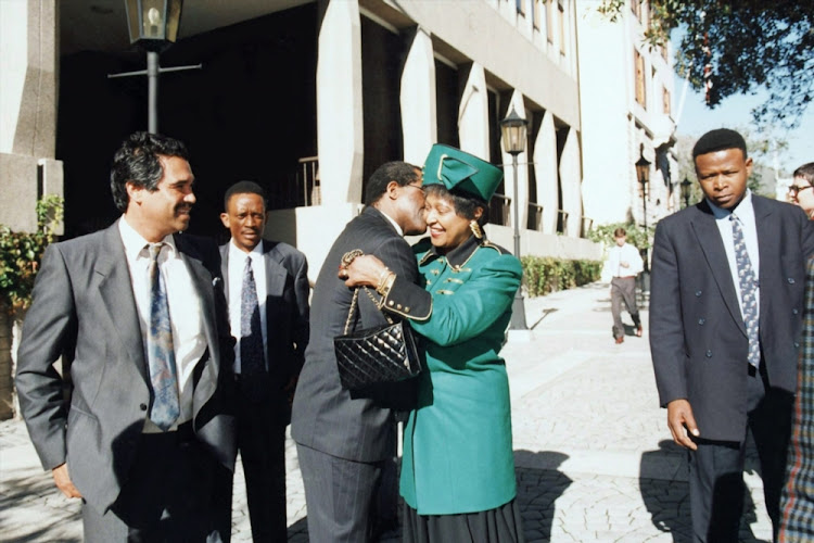 Winnie Mandela at the opening of Parliament in 1994. She was appointed deputy minister of arts, culture, science and technology in Mandela's unity government. The next year, she was sacked for insubordination but kept her position as member of Parliament and head of the powerful Women's League.