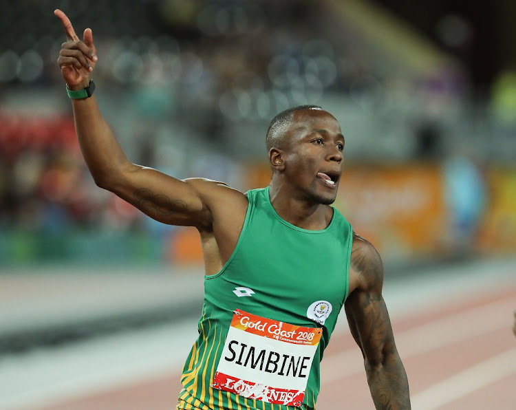 Lightning bolt: SA's Akani Simbine flies over the line to take the 100m gold on Monday. Picture: GALLO IMAGES