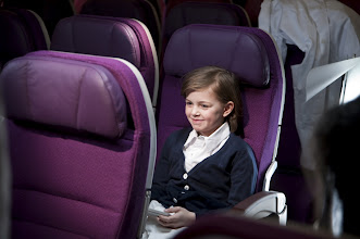 Photo: The little tyke waiting in the Economy seat.