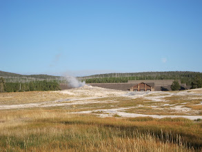 Photo: Old Faithful simmering (note lodge and moon in background)