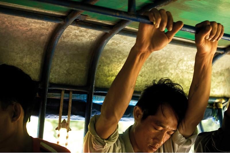 Photo: 3 Man asleep in public transport, Lao (c) Romain Philippon