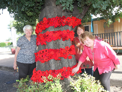 Left, Nancy Towns, who suggested the Craft Shop tree decorations, Lesley Williams and Alice Nehrkorn.