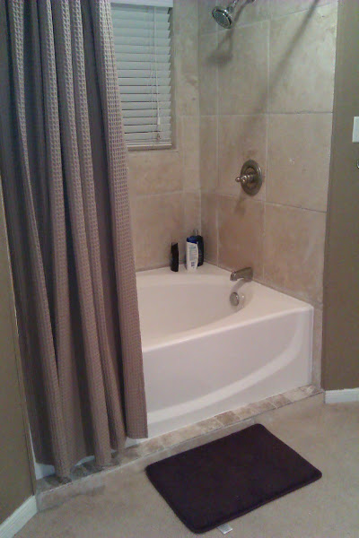 Photo: The rest of the bathroom is fairly tidy because we don't have a lot of products around the shower and tub area.