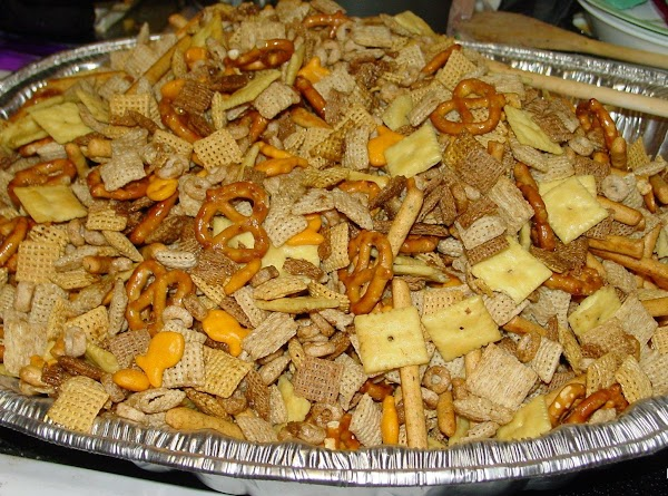 Add cereal mixture and nuts to the pan with melted butter and seasonings. Mix...