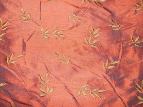 "Photo: <> STYLE# LEAVES-APRICOT <> WIDTH 54"" <> 100% SILK EMB. ON SHANTUNG <> PRICE $22.45/YRD <>"