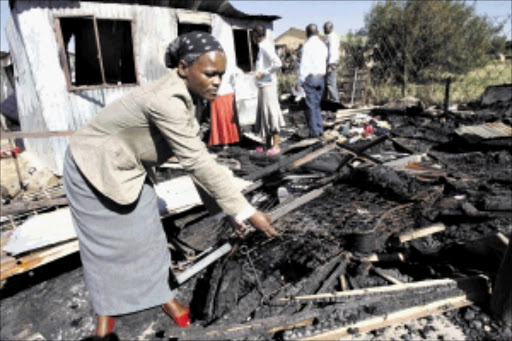 SAD BLOW: Helen Phaka lost her 11-month-old baby when her shack burned down in Ivory Park on Wednesday. Pic: ANTONIO MUCHAVE. 19/05/2010. © Sowetan.