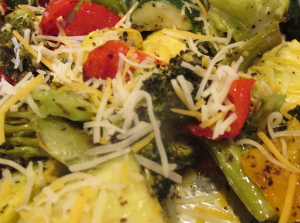 Remove from oven, and sprinkle lightly with shredded cheese while veggies are still hot....