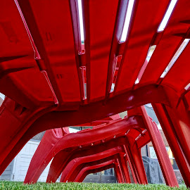 Under the Seat by Barbara Brock - Artistic Objects Furniture ( casual chairs, red chairs, looking up, plastic chairs, outdoor chairs, unique perspective, underneath )