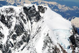 Photo: The team, just two black specks just below the summit ridge bergshrund.