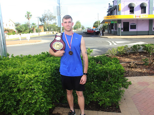 Narrabri boxer Brendan Davey with his Global Boxing League Australian Title belt and medal.