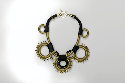 Jeweller Pichulik created a necklace inspired by the innate nature of the coins - the historical value and physical elements like the gold, the weight and the circles.