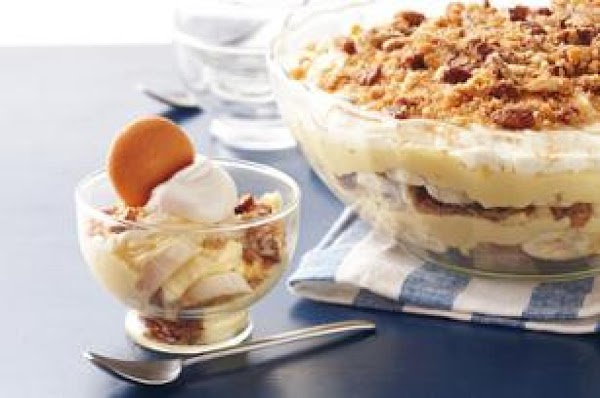 Pour whole and sweetened condensed milk into large bowl. Add dry pudding mixes. Beat...