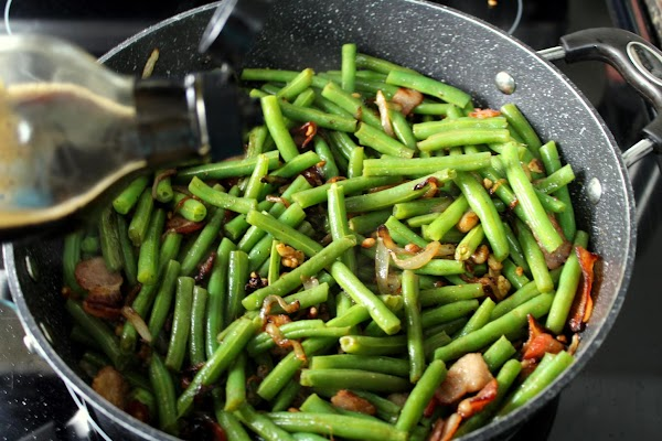 Add green beans to the mixture, sprinkle with soy sauce OR Worchestershire sauce, and...