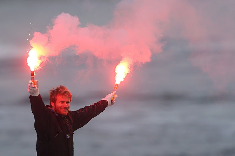 French skipper François Gabart celebrates with safety flares following his successful solo, non-stop around the world record trip, at Brest harbour, France, December 17 2017. Picture: REUTERS