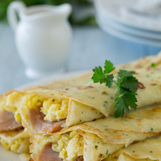 Herb Crepes with Eggs, Swiss, Ham and Browned Butter.