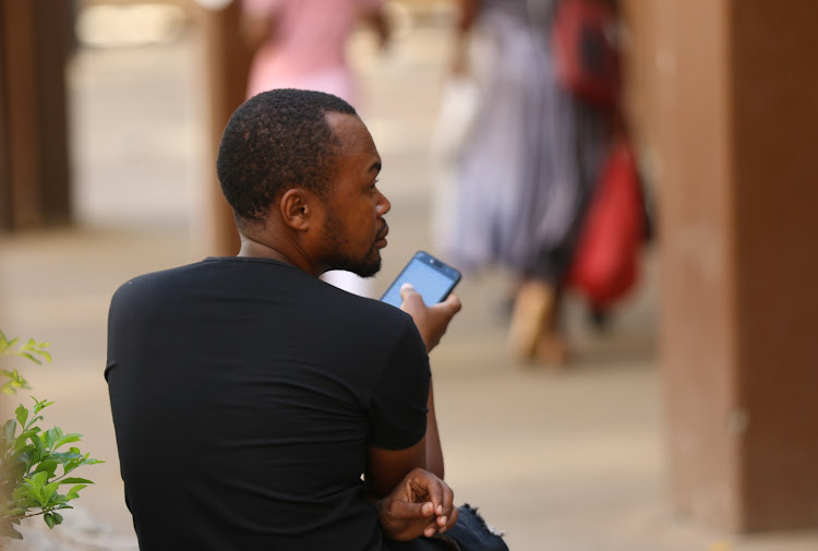 A man checks his mobile phone in Harare, Zimbabwe, January 18 2019.