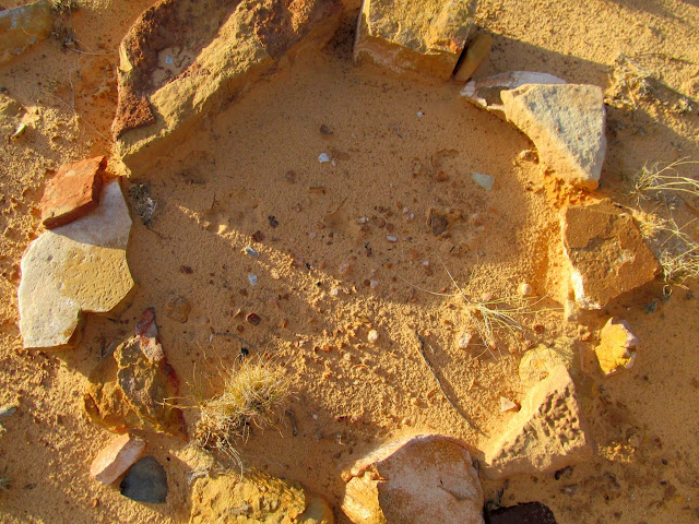 Old firepit with at least three metate fragments (and many lithic flakes)