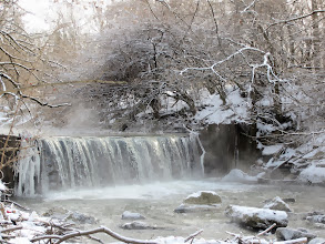 Photo: Winter waterfall under snowy branches and mist at Eastwood Park in Dayton, Ohio.