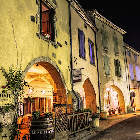 At the Restaurant by Marcel de Groot - City,  Street & Park  Historic Districts ( lights, village, street, lot-et-garonne, france, night, yellow, restaurant, sotiate, medieval, sos )
