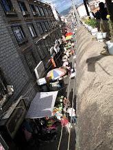 Photo: narrow alley off kora, restaurant window sill in foreground