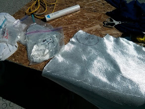 Photo: Cutting and labeling 1708 cloth in preparation for filling the deepest blisters. The cut cloth was placed in ziplock bags labeled to identify the blister for which they were cut.