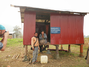 Photo: Landmine survivor Project Coordinator Nil Noy with Sa Ngem and new home