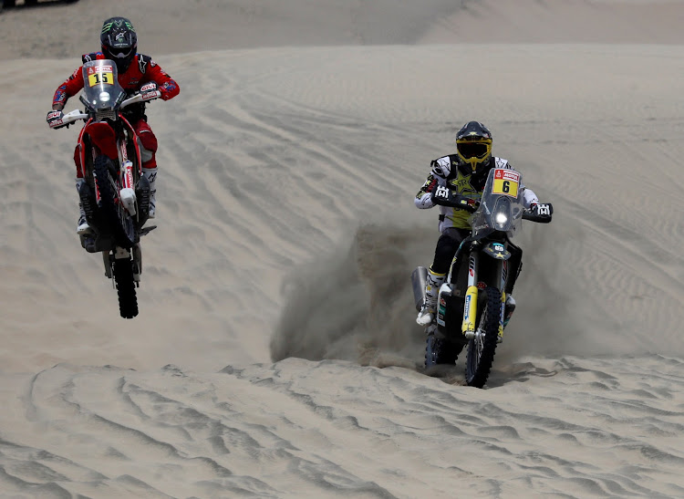 American Ricky Brabec (left) dices with Chile's Pablo Quintanilla in Peru's dunes. They lie respectively first and second overall in the Dakar 2019 motorcycle category after Thursday's stage. Picture: REUTERS