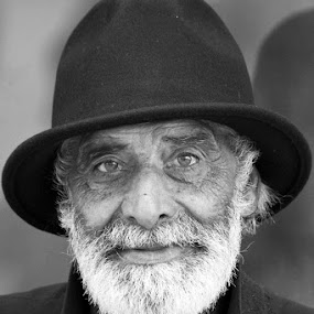 Eyes of an old Gipsy by Nuno Martins - People Portraits of Men ( beard, street, hat, suit, white, gipsy, black )
